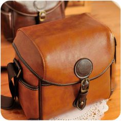 Hand Stitched DSLR Camera Bag in Brown Color can carry one set of DSLR Camera perfectly. $65.00, via Etsy.