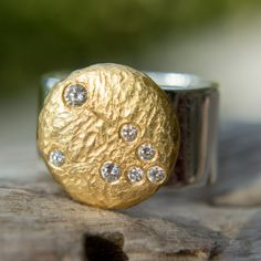 22k gold disc atop a sterling silver band features glittering high-quality diamonds outlining each of the 12 star sign constellations. Rings can be ordered with Aries, Taurus, Gemini, Cancer, Leo, Virgo, Libra, Scorpius, Sagittarius, Capricornus, Aquarius and Pisces constellations.
