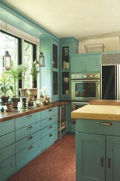 brown and turquoise kitchen | You could go bold with these dark turquoise kitchen cabinets.