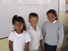 Giving out spectacles to local village school children.
