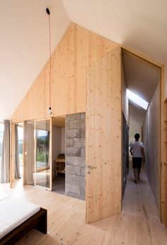 This house's pitched-roof form and use of timber cladding reference traditional barn-like structures called stodola.