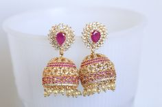 Jhumka has AAA quality CZ stones with macro gold plating and ruby stones Dimensions: inches in length Red Christmas, Christmas Wedding, Indian Jewelry Sets, Ruby Stone, Ear Rings, Jewellery Designs, Designer Jewelry, Gold Jewelry, Stones