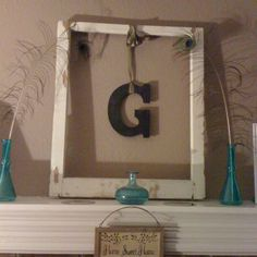 I finally decided what to do with the old window frame for our mantel.