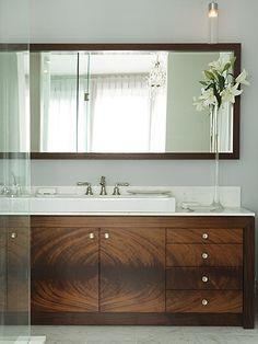 Beautiful contemporary linear vanity with well chosen patterns & one full length wood framed mirror.....the pairing is excellent.  (repinned photo from Sarah Richardson Design)