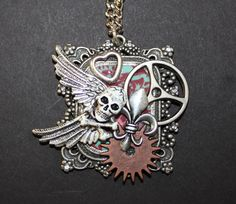 Funky skull necklace. I use what ever vintage, new, broken, jewelry I have around.