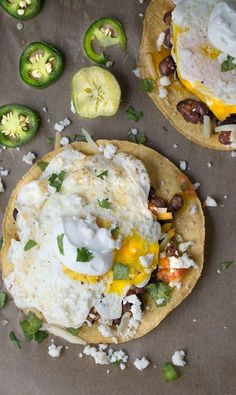 MOUTHWATERING Simple Breakfast Tostadas! A crunchy tostada is topped with over easy egg, black beans, cheddar, Queso fresco and a dollop of sour cream!