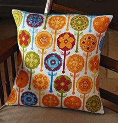 Retro Blooms cross stitch cushion pattern by Rebecca Tuffnell