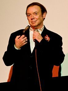 """Bud Cort at the Alamo Drafthouse in Austin.    """"Harold and Maude is my favorite movie ever and it was an absolute joy to see Bud Cort in person.  Even if he is a little peculiar. But would anything less be expected from Harold? :)""""...In a subsequent...""""shot, he's actually leading everyone in singing 'if you want to sing out, sing out'. It was SO awesome!""""  Detail of photo by Flickr member tibbygirl."""