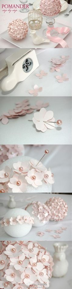 cherry blossom ball made by punching out paper flowers and pins