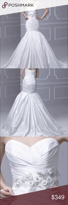 Enzoani Mermaid Wedding gown Beautiful wedding gown never worn, got it at a trunk show, Never used.  •Blue by Enzoani  • Retailed for: $1,568.00 •Style #: Formosa •Color: Ivory/Silver •Size: 12 • Bust: 38.5 • Waist: 30.5 • Hips: 42 •Brand new with tags (small stain on the inside cinch, smaller than a dime). •Fabric: Silky Dupion •Detachable Sash   ***check on your size before ordering, as you might already know wedding gowns run differently, (about 2 size smaller than regular clothing.)…