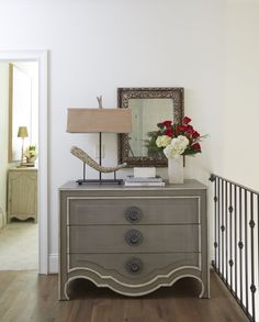 Hallways don't have to be relegated to dead space. An elegant dresser styled with a few unique accessories adds instant personality to your home and provides additional storage as well.