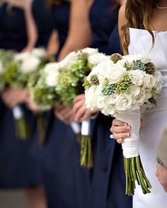 white and green bouquet, just add in some navy blue berries and curly ferns and this would be perfect!