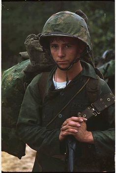 Da Nang Vietnam. A young Marine private waits on the beach during the Marine landing 3 August 1965.