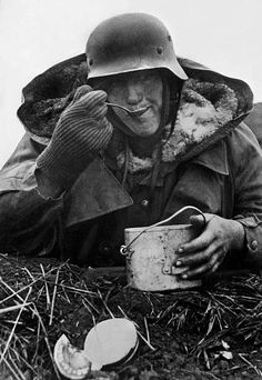 German soldier eating from a tin cup, eastern Front december 1943 - pin by Paolo Marzioli
