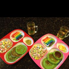 St. Patrick's Day breakfast: Lucky Charms, 1 gold coin, rainbow twizlers, and green pancakes with apple juice in a minni mug.