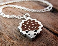 Jewelry made with concrete. In the shape of a hedgehog. Yes, please