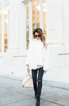 You can never go wrong with a fluffy white coat. Christine Andrew wears this winter trend with distressed black denim and ankle boots; an effortlessly stylish look perfect for any occasion! Sweater/Boots: Vince Camuto, Jeans: AG.