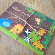 Jungle safari invitation with initial embellishment by Bespoke Party Products