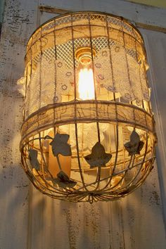 Distressed Shabby Recycled Cage Pendant Lighting: This birdcage makes a great recycled light fixture! Rusted and embellished with tea stained muslin and lace.