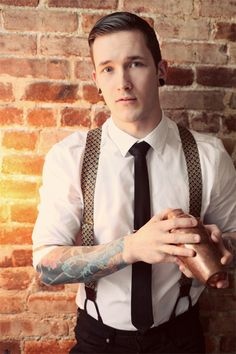 Suits and Tattoos / Suspenders and tattoos. I don't usually like tattoos (not), but this somehow works.