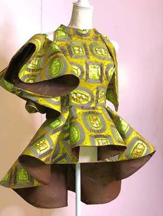 Call, SMS or WhatsApp if you want this style, needs a skilled tailor to hire or you want to expand more on your fashion business. African Print Dress Designs, African Print Dresses, African Print Fashion, African Dress, Ankara Designs, Ankara Peplum Tops, Ankara Dress Styles, African Blouses, African Tops