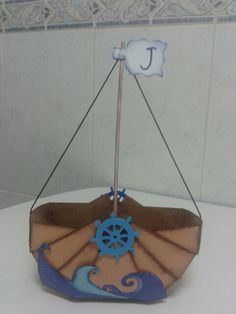 Barco-cesta. Ideal para guardar las cositas de aseo de un bebé