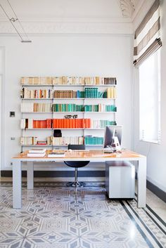 desk + fabulous colourful bookshelf