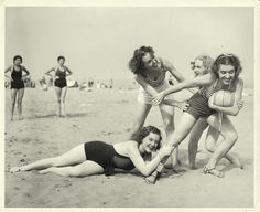 Girls playing with ball at the beach in the 1930s
