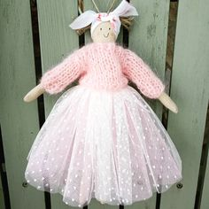 I used some delicate spotted netting for this doll, with a hint of pink underneath #handmadedolls #handknits #romantic #etsyuk #dollmakerofinstagram #pinkandwhite