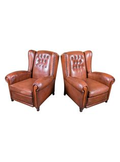 Pair of French Leather Tufted Wing Chairs with Reversible Cushions and Nailhead Trim