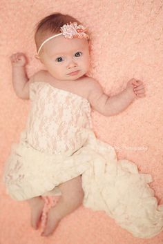 beautiful 4-month-old baby girl with Down Syndrome, unique fine art baby portraits by Olga Klofac Professional Baby Photographer Charlestown Mayo