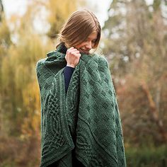 Alternating garter and stockinette stitch in worsted weight yarn make an elegant blanket, bordered with a cabled knot edging. Meditative to make with a challenging twist, the Stornaway Throw is sure to become an heirloom for your home.