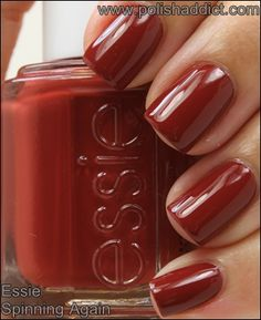 Essie Spinning Again is a dark brick red crème – (red terracota-like)