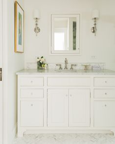 Master bathroom vanity. Beautiful beaded detail on  door in Dove White with marble accents. Designed by Kathy Marshall for This Old House Charlestown.
