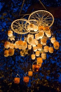 wire, candles, jars and bicycle spokes to create a gorgeous bottle chandelier for your backyard