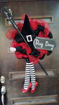 """Wizard of Oz 16"""" Burlap and Deco Mesh Wreath.  Ruby red slippers attached to striped witch legs."""