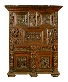 A large mid-16th century Continental Dower oak cupboard.  Exact Date: 1560-1600 Country of Origin: Germany  Measurements Metric: 2.46M H x 1.65M L x 72cm W