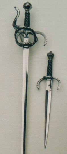 Pair of weapons Germany  Rapier, from about the year 1610.  Total length: 1160 mm Length of the blade: 1020mm Width of the blade: 27mm Weight: 1090 g Balance point: 70-75mm from quillon  Cataloque No. 2000220  Left handed dagger,  Total length: 460mm Length of the blade: 330mm Width of the blade: 27mm Weight: 430g  Cataloque No. 2000312