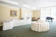 Hoover Country Club Weddings. Summer wedding. Buffet tables set up in the Living Room. White linens. Piano. simple reception. Birmingham, Alabama