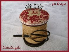this is a very neat link, with tons of ideas and inspiration.  on the picture you need a large vintage spool (not hard to acquire), twine, beautiful ribbon and fabric and a pair of small scissors.  simple and charming