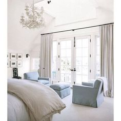 A soothing and soft bedroom full of light via Victoria Hagan Interiors. Here's a quick tip: Hang curtains extra wide, clearing the window front to let in as much light as possible. In love with all of this!