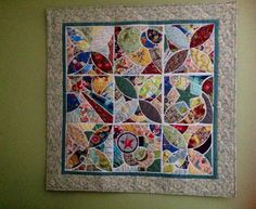 This is my finished project from the book Tile Revival.  Hand turned applique.  I really enjoyed working on this quilt.