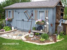 Decorate your shed with old tools, birdhouses, window boxes, and don't forget a potting table!  Gallery of best garden sheds