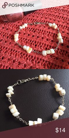 Handmade white gemstone and silver bracelet Beautiful bracelet made with white gemstone chips and silver colored chain and clasp. This style can also be made in necklace form - this would make a great gift set!! Melody Design Jewelry Bracelets