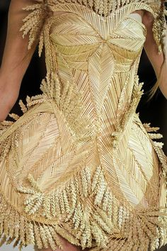 Speaking of braided (woven) grass....holy kucka!     ~Alexander McQueen  It's ugly in some ways but cool in others.