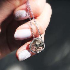 Loriann Stevenson's diamond slice pendant set in 18k white gold with white diamond pave. #18k #whitegold #diamondslice #diamondpave #loriannstevenson #finejewelery #jewellery #lovegold #futureheirlooms #augustla