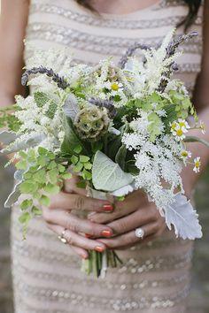 bridesmaid bouquet with assorted greenery #bridesmaidbouquet #bouquet #babysbreath http://www.weddingchicks.com/2014/01/21/good-mood-metallic-wedding/
