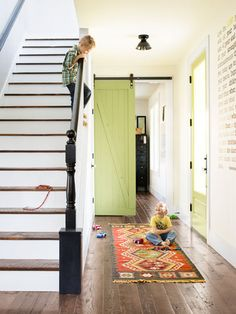 "Sliding ""Barn"" Door - A Handmade Home from Country Living Squeaky Floors, Barn Door Hardware, Barn Doors, Barnwood Doors, Sliding Doors, Green Home Decor, Painted Stairs, Green Rooms, Entry Hall"
