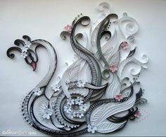 Paper Quilling Birds Design - handmade paper art by Svetlana Belova. Would be amazing to see the process of how this bird was made!