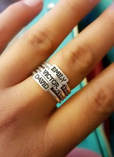 Say it on a Ring™ with a personalized custom handcrafted ring made from nickel-free fine silver. Add up to 5 names and 4 spacer bands.